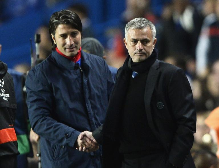 Chelsea's manager Mourinho shakes hands with his Basel counterpart Yakin after their Champions League soccer match at Stamford Bridge in London