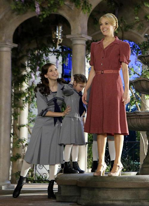 "This image released by NBC shows Carrie Underwood, right, as Maria, and fellow cast members Ariane Rinehart as Liesl, left, and Peyton Ella as Gretl, during preparations for ""The Sound of Music Live!, in Bethpage, N.Y. The live production airs on Dec. 5 at 8 p.m. EST. (AP Photo/NBC, Paul Drinkwater)"