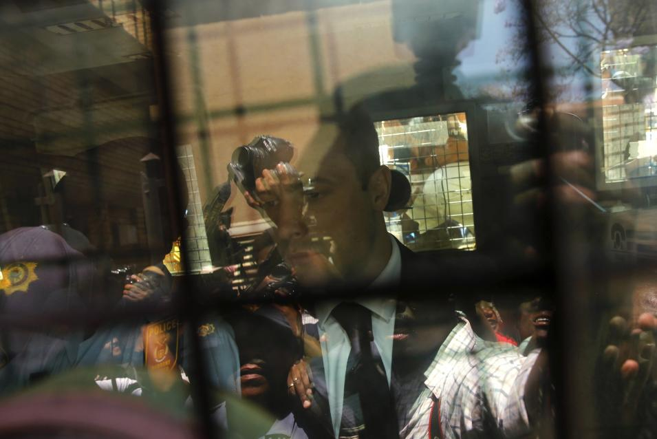 South African Olympic and Paralympic sprinter Pistorius is seen in a police van after his sentencing at the North Gauteng High Court in Pretoria