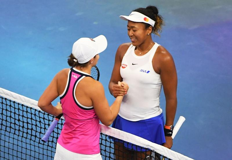 Naomi Osaka of Japan (R) shakes hands with Ashleigh Barty of Australia after Osaka won their women's singles final at the China Open tennis tournament in Beijing on October 6, 2019. (Photo by GREG BAKER/AFP via Getty Images)