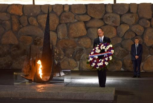 Britain's Prince William lays a wreath during a visit to the Yad Vashem Holocaust memorial in Jerusalem on June 26, 2018