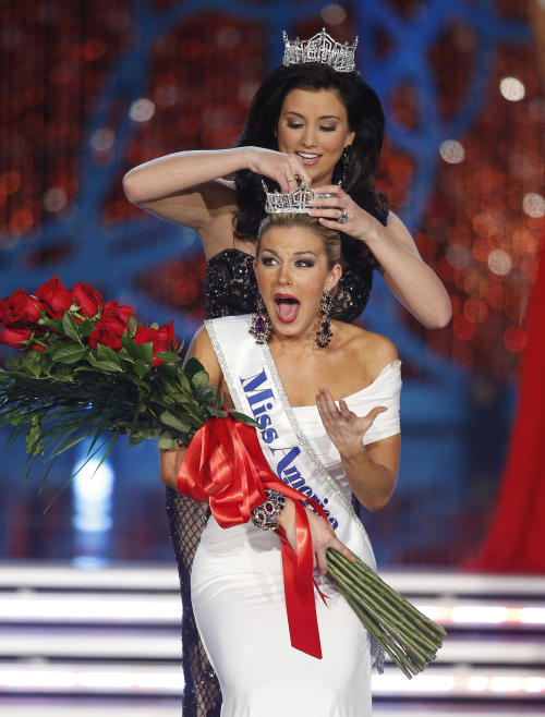 Miss New York Mallory Hagan is crowned Miss America 2013 by Miss America 2012 Laura Kaeppeler on Saturday, Jan. 12, 2013, in Las Vegas. (AP Photo/Isaac Brekken)