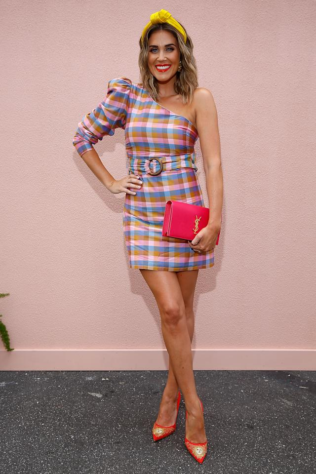 <p>The former Bachelorette stands out in a pink, blue and orange tartan-print minidress, custom-made by Atoir. Photo: Getty </p>