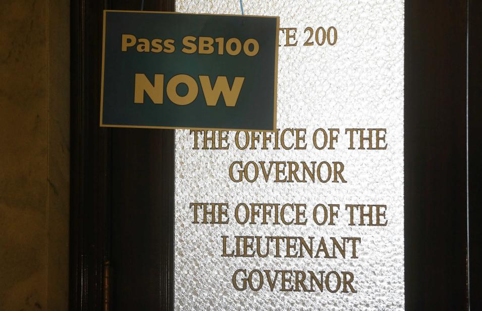 A sign hangs on the blocked door to the governor's office at the Utah State Capitol building in Salt Lake City