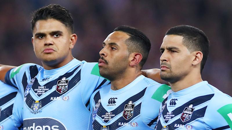 Latrell Mitchell, Josh Addo-Carr and Cody Walker stood arm in arm for the national anthem. Pic: Getty