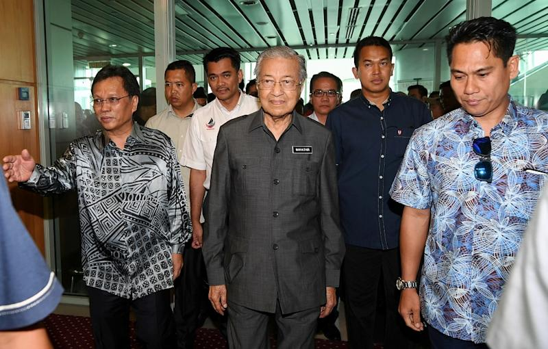 File picture shows then-Prime Minister Tun Dr Mahathir Mohamad being greeted by Sabah Chief Minister Datuk Seri Mohd Shafie Apdal (left) upon his arrival at the Kota Kinabalu Airport September 16, 2018. — Bernama pic