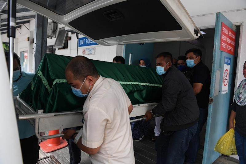 The family members of Sharifah Fariesha Syed Fathi, 21, are seen at the Forensic Unit of Hospital Seberang Jaya. Sharifah Fariesha and two others died due to CO poisoning after they fell asleep in a parked car with the engine running. ― Bernama pic