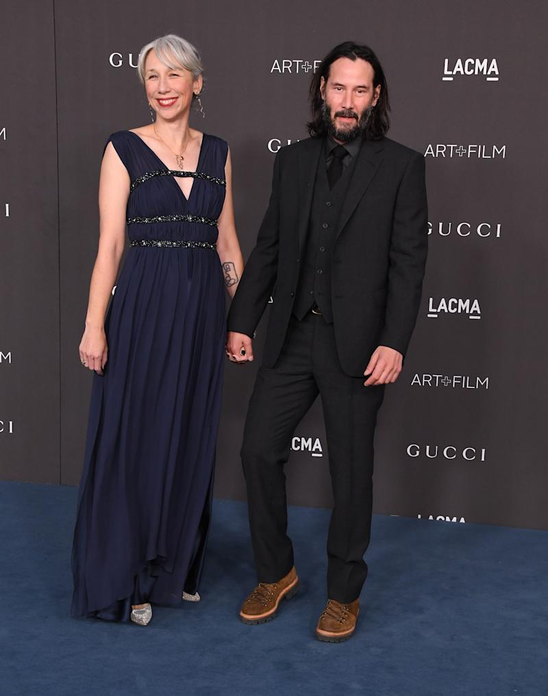 A photo of Alexandra Grant and Keanu Reeves on the red carpet at the 2019 LACMA Art + Film Gala at LACMA on November 02, 2019 in Los Angeles, California.