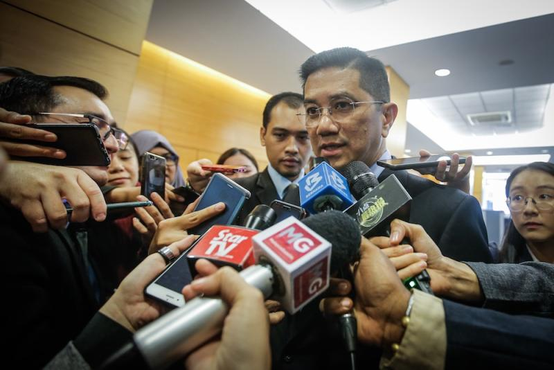 Economic Affairs Minister, Datuk Seri Azmin Ali, speaks to reporters in the lobby of Parliament November 19, 2019. — Picture by Hari Anggara