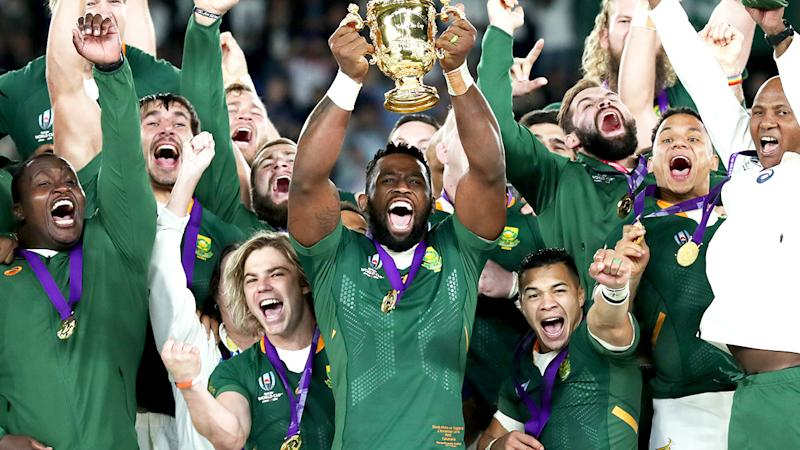 South African captain Siya Kolisi, pictured lifting the Webb Ellis trophy after winning the Rugby World Cup.