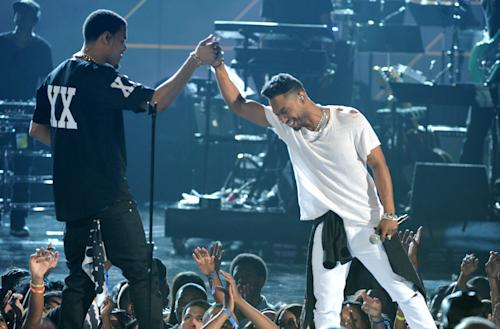 J. Cole, left, and singer Miguel perform onstage at the BET Awards at the Nokia Theatre on Sunday, June 30, 2013, in Los Angeles. (Photo by Frank Micelotta/Invision/AP)