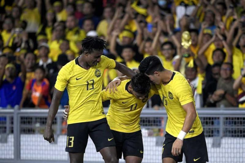 Muhammad Safawi Rasid celebrating with his teammates after scoring against Indonesia. — Bernama pic