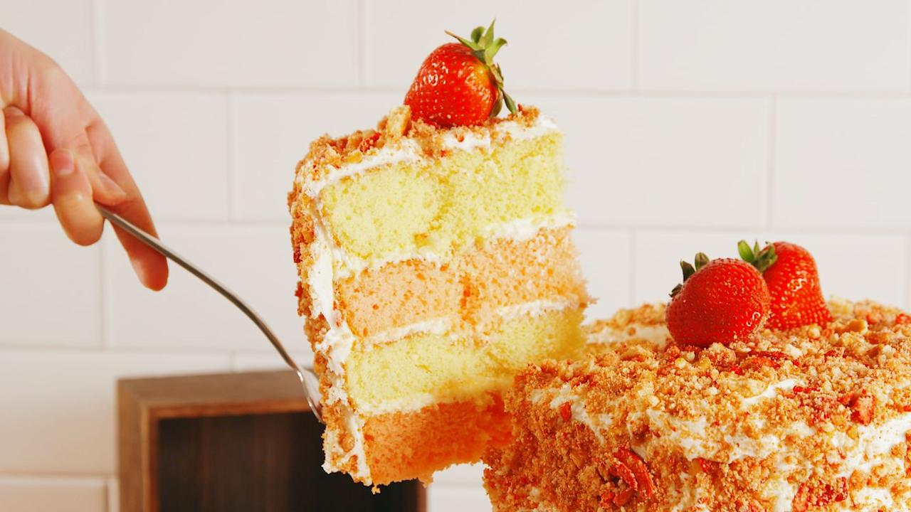 """<p>The cake version of your favorite summer ice cream bar!</p><p>Get the recipe from <a href=""""https://www.delish.com/cooking/recipe-ideas/recipes/a52899/strawberry-crunch-cake-recipe/"""" target=""""_blank"""">Delish</a>.</p>"""
