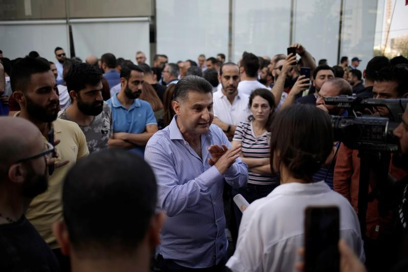Rami Assoum speaks to Reuters during a protest in Beirut