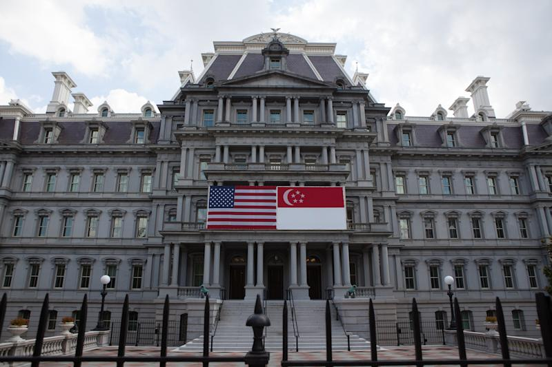 Washington, D.C. On Tuesday, August 2, United States and Singapore flags hang on the front of the Eisenhower Executive Office Building, in honor of a State visit to the White House by Prime Minister Lee Hsien Loong. (Photo by Cheriss May/NurPhoto via Getty Images)