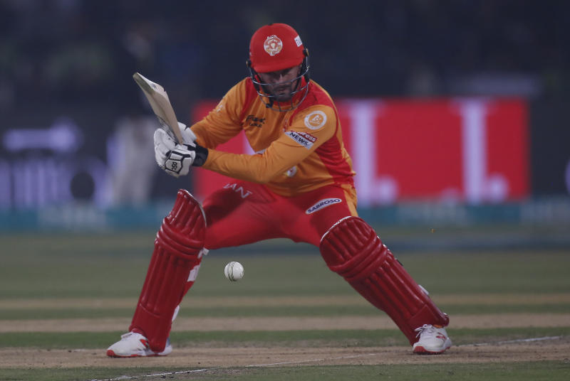 Colin Munro of Islamabad United hits boundary against Lahore Qalandars during a Pakistan Super League T20 match in Lahore, Pakistan, Wednesday, March 4, 2020. (AP Photo/K.M. Chaudary)