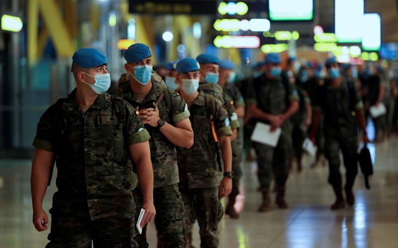 Spanish soldiers deployed to the United Nations Interim Force in Lebanon (UNIFIL) wear face masks as they prepare to travel to the Middle Eastern country following six months of training and two weeks of quarantine - MARISCAL/EPA-EFE/Shutterstock