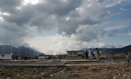 """In this photo taken on Feb. 15, 2013, Pakistani children play at the demolished compound of Osama bin Laden in Abbottabad, Pakistan. Pakistan stars in """"Zero Dark Thirty,"""" from early scenes at a detention site to the dramatic closing minutes as Navy SEALs assault the hideout of bin Laden. But the Academy Award-nominated film about the hunt for the al-Qaida leader has sparked a controversy here about its portrayal of the country, and it will likely not be shown on the local big screen anytime soon. Partly, the film taps into national discomfort that bin Laden was found to be living for years near Pakistan's equivalent. (AP Photo/Aqeel Ahmed)"""