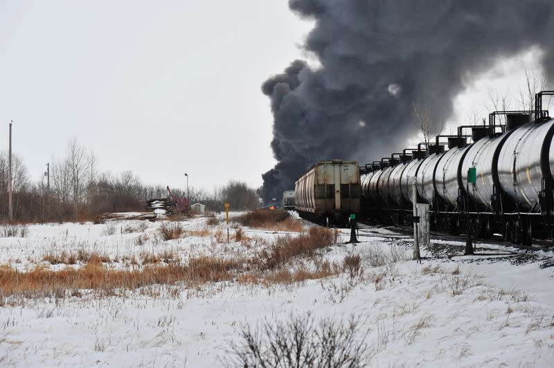 Smoke rises from a fire at the site of a CP Rail train car derailment near Guernsey