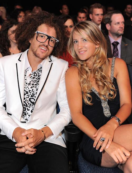 Redfoo, of musical duo LMFAO, left, and tennis player Victoria Azarenka pose in the audience at the ESPY Awards on Wednesday, July 17, 2013, at Nokia Theater in Los Angeles. (Photo by Jordan Strauss/Invision/AP)
