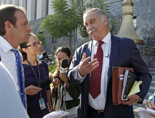 """Steve Seiden, attorney for Mark Basseley Youssef, speaks after a hearing for his client at U.S. District Court in Los Angeles Wednesday, Nov. 7, 2012. Youssef was sentenced to a year in prison for violating his probation stemming from a 2010 bank fraud conviction by lying about his identity. He admitted to four of the eight alleged violations, including obtaining a fraudulent California driver's license. None of the violations had to do with the content of """"Innocence of Muslims,"""" a film that depicts Mohammad as a religious fraud, pedophile and a womanizer. The movie sparked violence in Libya and other parts of the Middle East, killing dozens. (AP Photo/Reed Saxon)"""