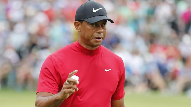 Tiger Woods is slowly reeling in leader and playing partner Francesco Molinari at the Masters