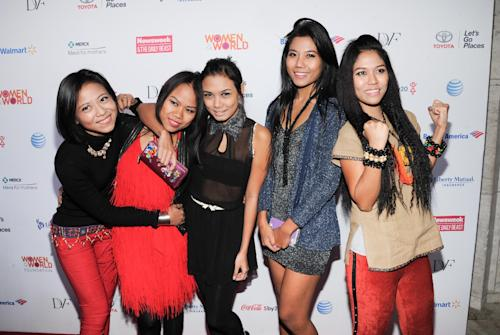 """Pop/hip-hop group and dance ensemble from Myanmar, """"Me N Ma Girls,"""" attend the 4th Annual Women in the World Summit at the David H. Koch Theater on Thursday, April 4, 2013, in New York. (Photo by Evan Agostini/Invision/AP)"""