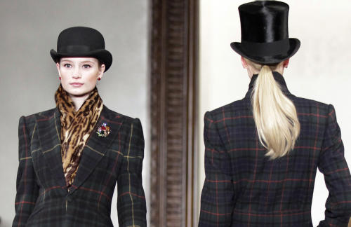 "FILE - This Feb. 16, 2012 file photo shows fashion from the Fall 2012 collection of Ralph Lauren in New York. The preview of Ralph Lauren's fall collection, held earlier this year, paid homage to ""Downton Abbey"", with models walking down the runway to the music of the show. Lauren had he was inspired by ""the heritage and romance of England."" (AP Photo/Bebeto Matthews, file)"