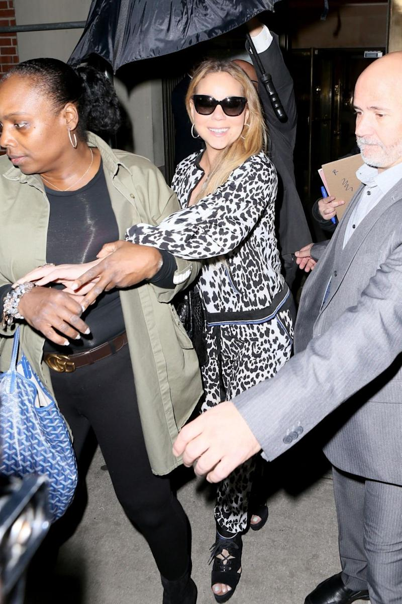 Mariah Carey makes her way through a crowd of fans and autograph seekers as she leaves her apartment heading to the Beacon Theatre in New York for her concert. Source: Backgrid