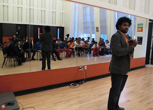 "In this March 22, 2013 photo, vocal coach Justin Merrick talks to students at Stax Music Academy in Memphis, Tenn. The Stax Music Academy is an after-school program where teenagers from some of Memphis' poorest neighborhoods learn how to dance, sing and play instruments. The academy's students play annual shows in Memphis and have toured to Washington, Italy and Australia, helping spread the soulful ""Memphis Sound."" (AP Photos/Adrian Sainz)"