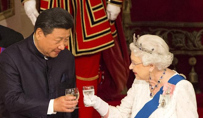 "Chinese President Xi Jinping with Britain's Queen Elizabeth II during a state banquet in 2015 – hailed as a ""golden age"" in relations. Photo: AP"