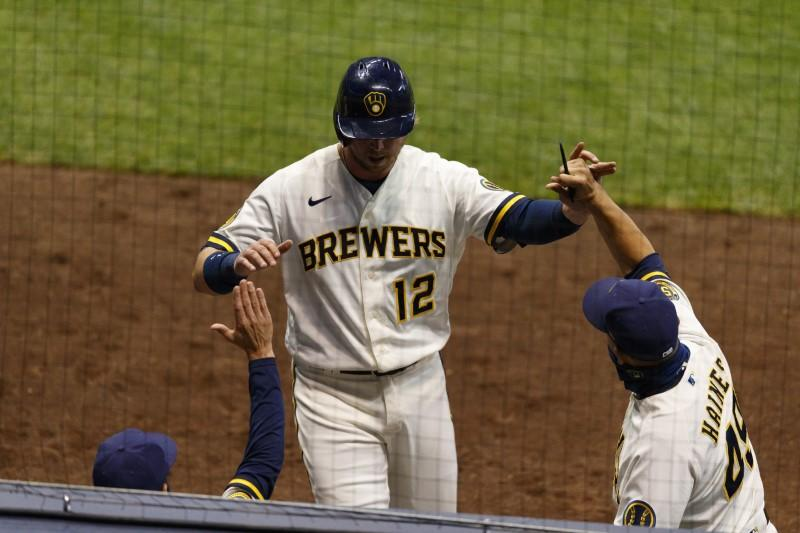 Brewers break out in sixth, club Reds 9-3