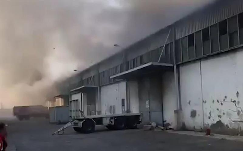 Smoke billows from the port warehouse - Twitter