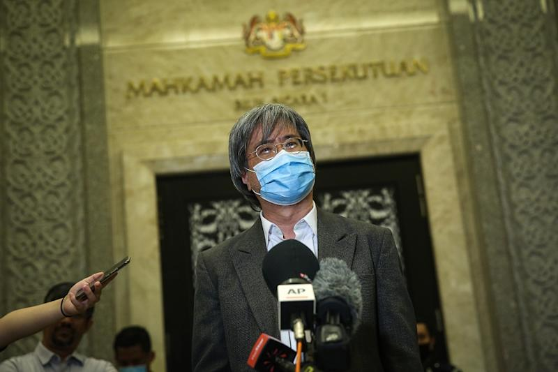 Malaysiakini editor-in-chief Steven Gan speaks to reporters outside the courtroom at the Federal Court in Putrajaya July 2, 2020. ― Picture by Yusof Mat Isa