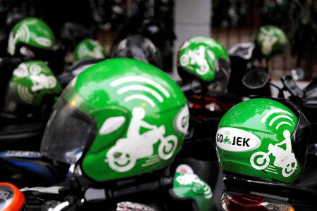Gojek driver helmets are seen during Go-Food festival in Jakarta, Indonesia, October 27, 2018. Picture taken October 27, 2018. REUTERS/Beawiharta