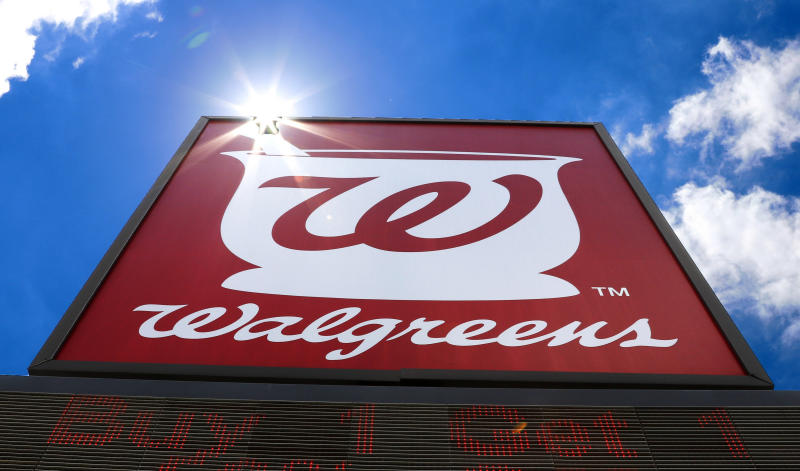 FILE - This Tuesday, June 25, 2019, file photo shows the sign outside a Walgreens Pharmacy in Pittsburgh. Drugstore chains Walgreens and CVS Health say they will stop locking up beauty and hair care products aimed at black women and other women of color. (AP Photo/Gene J. Puskar, File)