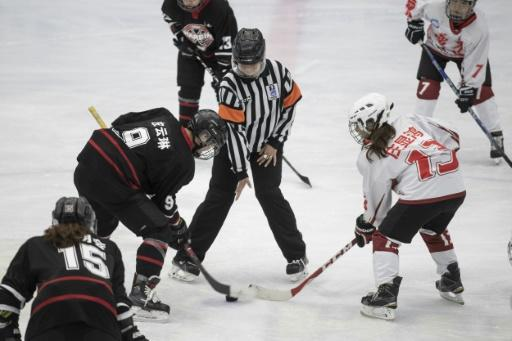 The Harbin women's ice hockey team face off against Guangzhou at China's national ice hockey championships in Beijing