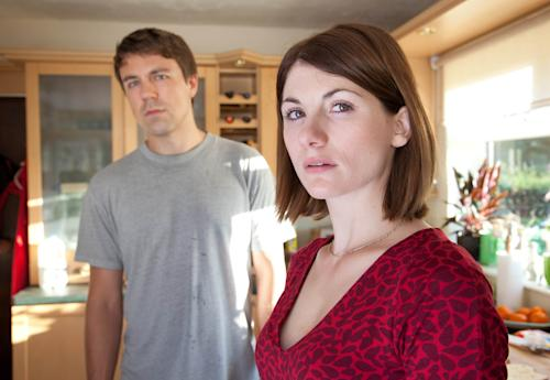 "This publicity image released by BBC America shows Jodie Whittaker as Beth Latimer, right, and Andrew Buchan as Mark Latimer from the series ""Broadchurch,"" premiering Aug. 7 at 10 p.m. EST. (AP Photo/BBC America, Patrick Redmond)"