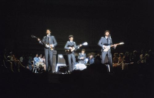 FILE- In this Feb. 12, 1964 file photo, the Beatles, from left Paul McCartney, George Harrison, Ringo Starr on drums, and John Lennon, perform at Carnegie Hall in New York. Sid Bernstein, the music promoter who brought the Beatles to American and was responsible for the Carnegie Hall concert, died Wednesday, Aug. 21, 2013 in a New York City Hospital. He was 95. (AP Photo/File)