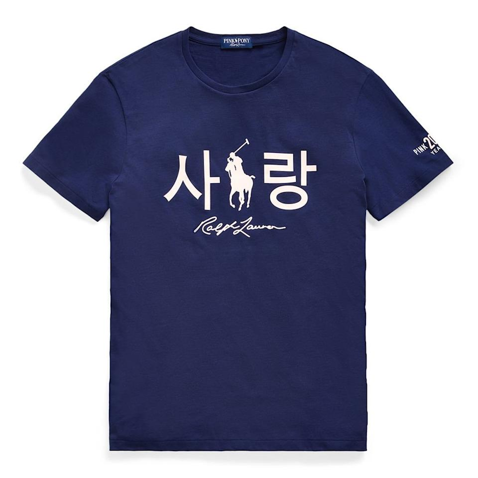 """<p><strong>Ralph Lauren </strong></p><p>ralphlauren.com</p><p><strong>$68.00</strong></p><p><a href=""""https://go.redirectingat.com?id=74968X1596630&url=https%3A%2F%2Fwww.ralphlauren.com%2Fwomen-clothing-t-shirts%2Fpink-pony-korean-love-tee%2F559243.html&sref=https%3A%2F%2Fwww.elle.com%2Ffashion%2Fshopping%2Fg34276577%2Fbca-awareness-month-fashion%2F"""" target=""""_blank"""">Shop Now</a></p><p>In 2000, Ralph Lauren launched the <a href=""""https://www.ralphlauren.com/brands-polo-ralph-lauren-women-pink-pony-feat?en_US_pdp_pinkpony_slot_1_s1_L1_shop"""" target=""""_blank"""">Pink Pony Campaign</a>, the brand's global initiative to fight cancer. To celebrate its 20th anniversary, they debuted a series of conversations between survivors, stories from front line healthcare workers, and digitized their annual Pink Pony Walk, so you can participate safely during the pandemic. 25% of the proceeds from this tee—which comes in multiple languages—benefit programs for cancer screenings, early treatment, research, and patient navigation</p>"""