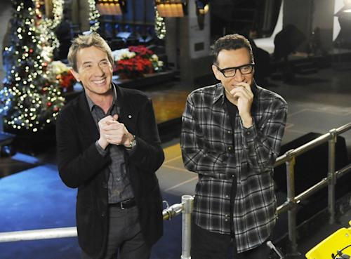 """This Dec. 11, 2012 photo released by NBC shows Martin Short, left, with cast member Fred Armisen on the set of """"Saturday Night Live,"""" in New York. Short will guest host on the popular late night program along with musical guest Paul McCartney. (AP Photo/NBC, Dana Edelson)"""