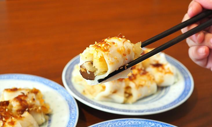 The rice rolls are stuffed with shredded carrots and yam bean cooked in chicken stock and mushrooms