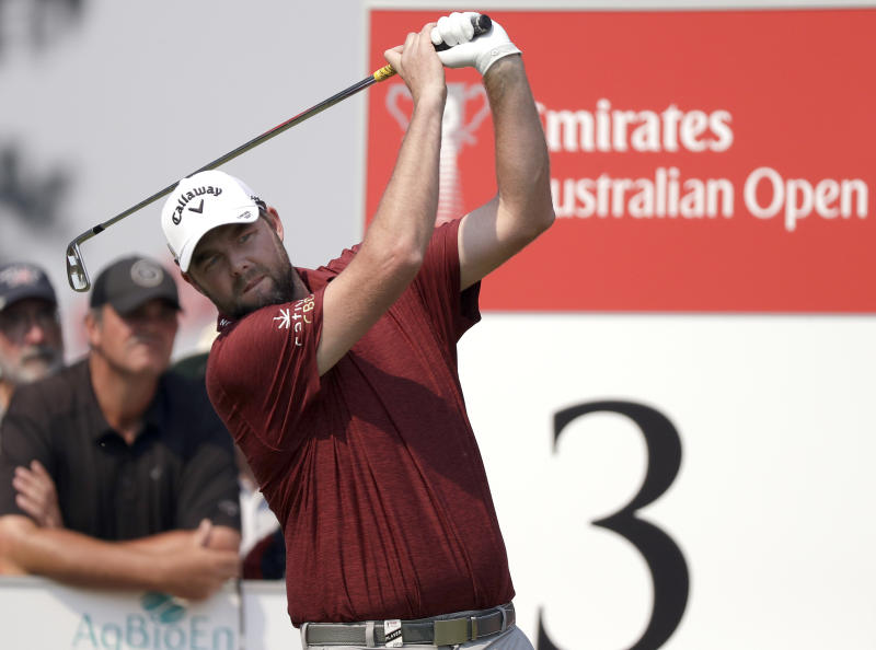 Australia's Marc Leishman tees off on the 3rd hole during the opening round of the Australian Open golf tournament in Sydney, Thursday, Dec. 5, 2019. (AP Photo/Rick Rycroft)