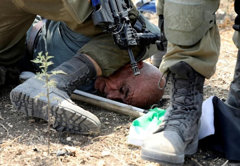 Image of Palestinian under Israeli soldier's knee sparks outrage