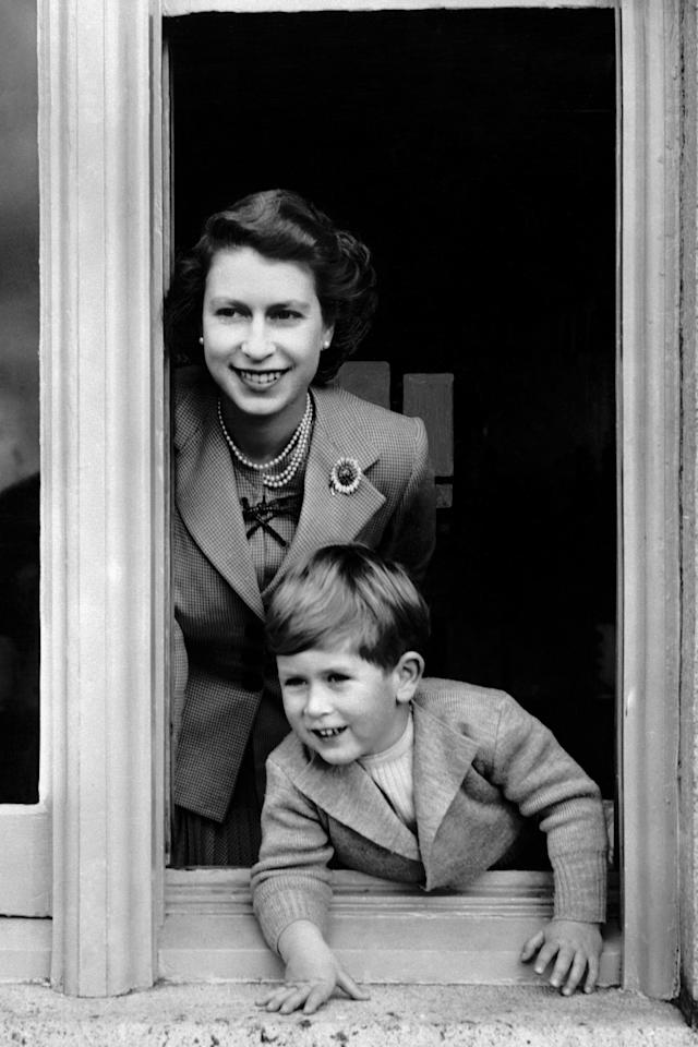 <p>The Queen and Charles in 1952 (PA) </p>