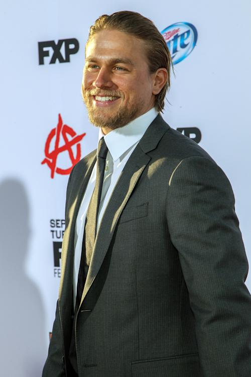 "Actor Charlie Hunnam arrives at the season 6 premiere screening of ""Sons of Anarchy"" at the Dolby Theatre on Saturday, Sept. 7, 2013 in Los Angeles. (Photo by Paul A. Hebert/Invision/AP)"