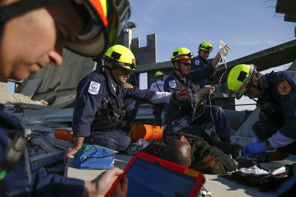 Rescue specialists for USA-1 work on a role playing patient rescued from the scene of a mock disaster area during a training exercise at the Guardian Center in Perry
