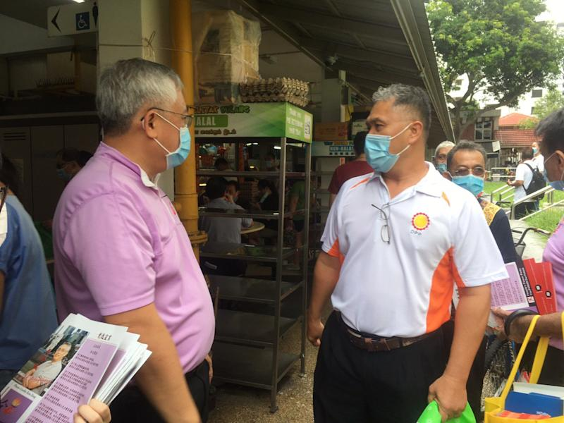 People's Power Party founder Goh Meng Seng with Democratic Progressive Party secretary-general Mohamad Hamim Aliyas at the MacPherson Market & Food Centre on Saturday morning (27 June). (Photo: Christalle Tay / Yahoo News Singapore)