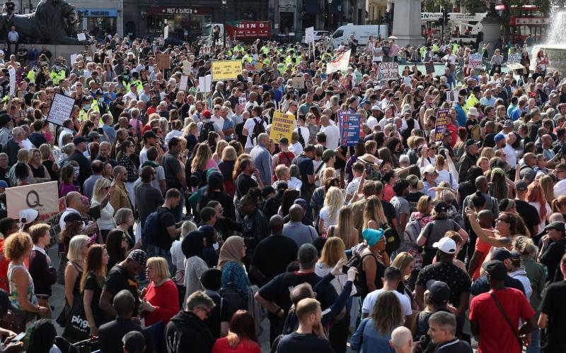 Demonstrators at an anti-vax protest in London's Trafalgar Square - PA