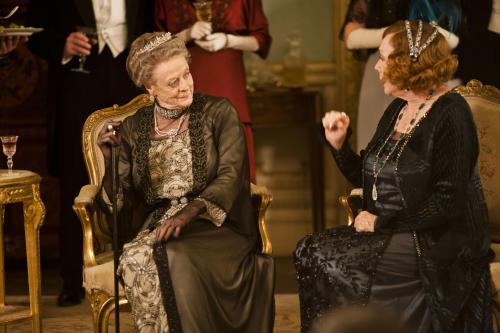 "This undated publicity photo provided by PBS shows Maggie Smith as the Dowager Countess, left, and Shirley MacLaine as Martha Levinson from the TV series, ""Downton Abbey."" The third season premiere airs in the U.S. on Sunday, Jan. 6, 2013 on PBS. (AP Photo/PBS, Carnival Film & Television Limited 2012 for MASTERPIECE, Nick Briggs)"